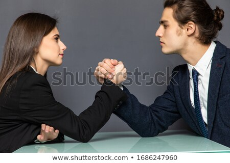 opposites attract Stock photo © dolgachov