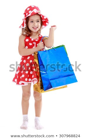 Stock photo: Surprised women in red dress with little shopping bags