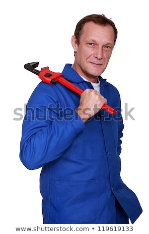 Plumber holding wrench over shoulder Stock photo © photography33