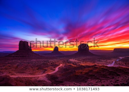 Monument Valley landscape with clouds and dirt road stock photo © snyfer