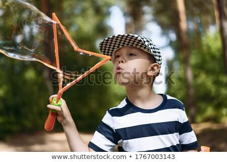 Szczęśliwy dziecko pasiasty cap zewnątrz Zdjęcia stock © ryhor