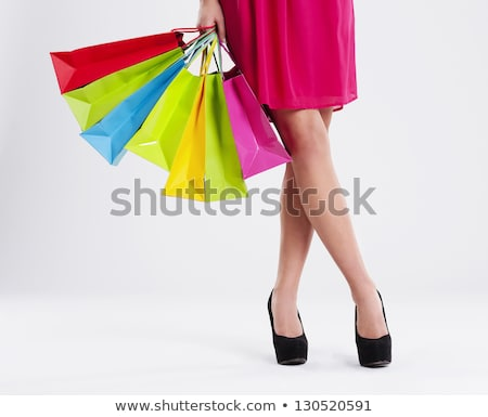 Elegant legs with shopping bags Stock photo © AndreyPopov