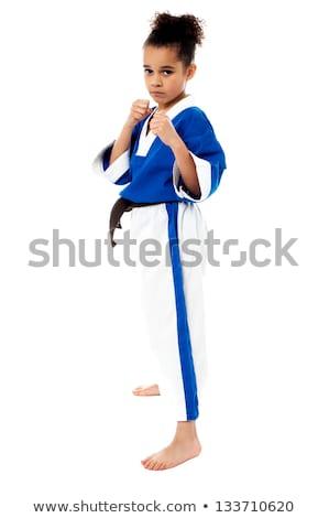 Prêt concurrence petite fille pratique karaté Photo stock © stockyimages