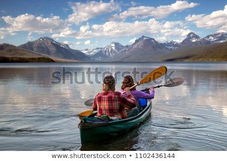 Couple kayak réflexion eau été hommes Photo stock © ddvs71