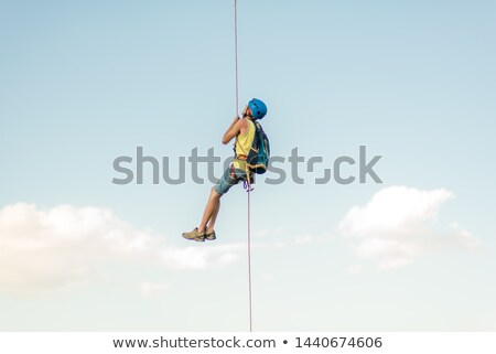 One hand hanging on to rocks Stock photo © Habman_18