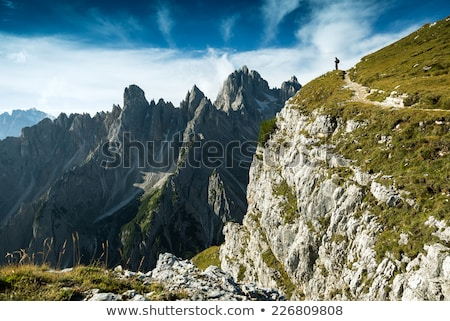 Italy, Dolomites - Man hiker standing on the barren rocks  Stock photo © Geribody