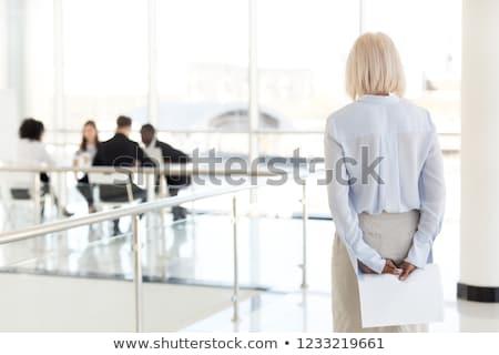 verlegen · zakenvrouw · jonge · document · gezicht · business - stockfoto © elwynn