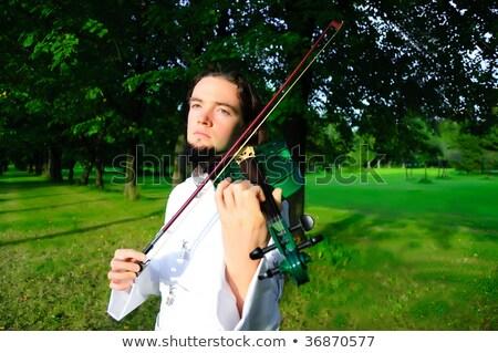 Dark-haired young guy with violin Stock photo © konradbak