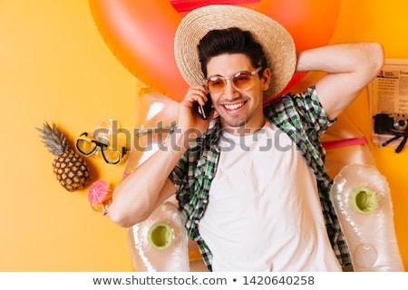 attractive young man lying on studio background stock photo © feedough