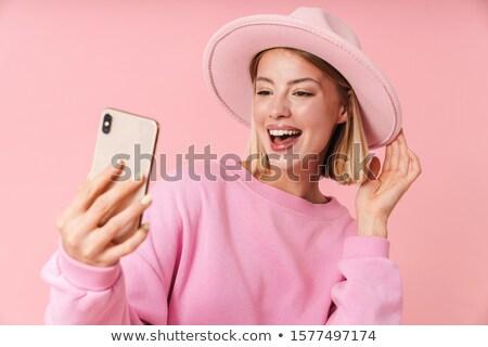 Gorgeous Blond Woman Taking Selfie Photo Stock photo © dash