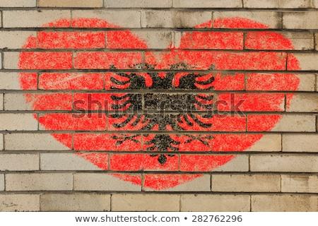 A forma di cuore bandiera Albania muro di mattoni cuore Foto d'archivio © vepar5