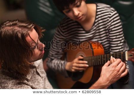 гитаре · урок · музыку · улыбка · счастливым · образование - Сток-фото © feverpitch
