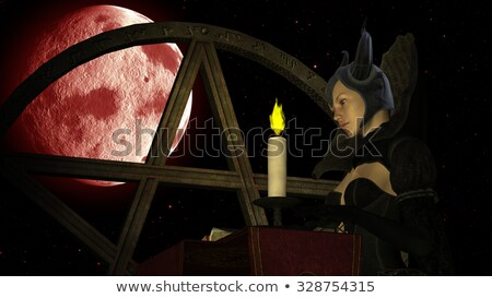 Witch reading Magic book with Candle light at Red Moon background with Pentacle Stock photo © ankarb