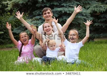 family of five rejoice outdoor in summer sit on grass Stock photo © Paha_L