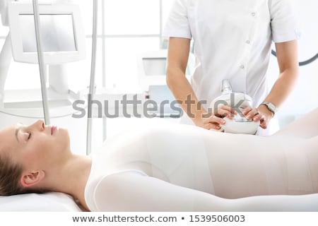 Beautician Using Cellulite Vacuum On Woman's Thigh Stock photo © AndreyPopov