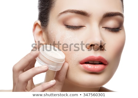 Beautiful girl holding jar with loose powder Stock photo © svetography