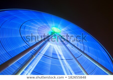 Lights shine from giant spinning wheel Stock photo © jeffmcgraw