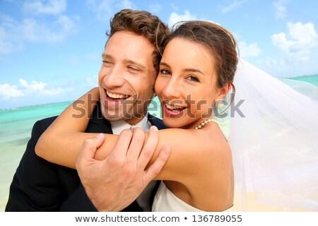 romantische · echtpaar · permanente · lachend · strand · zonsondergang - stockfoto © deandrobot