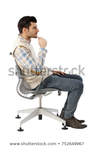 side view of a seated young businessman Stock photo © feedough