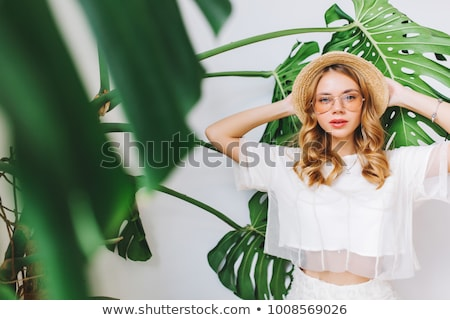 Cheerful lovely young woman with green leaves Stock photo © deandrobot