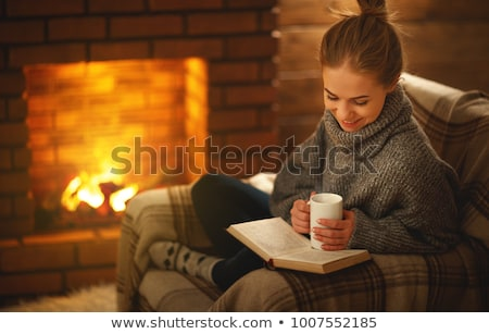 reading and drinking dark coffee for the autumn season stock photo © tab62