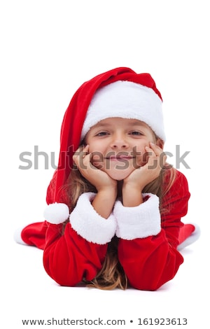 Adorable girl in Christmas outfit lying on the floor Stock photo © dash