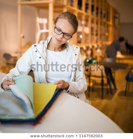 Pretty young woman  choosing the right material/color stock photo © lightpoet