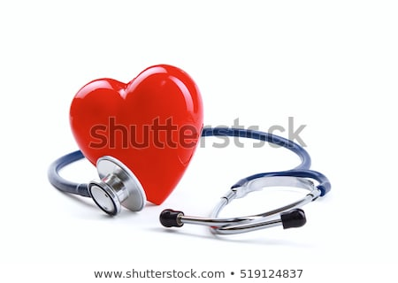 red heart and a stethoscope on desk stock photo © andreypopov