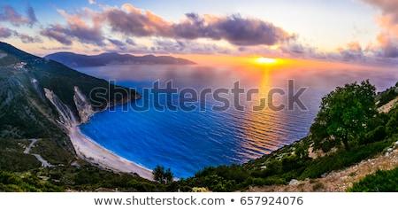 Gorgeous sunset over most beautiful beach Myrtos, Kefalonia island Stock photo © Freesurf
