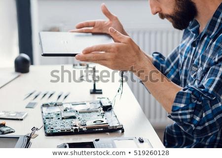 Laptop képernyő karbantartás modern munkahely mutat Stock fotó © tashatuvango