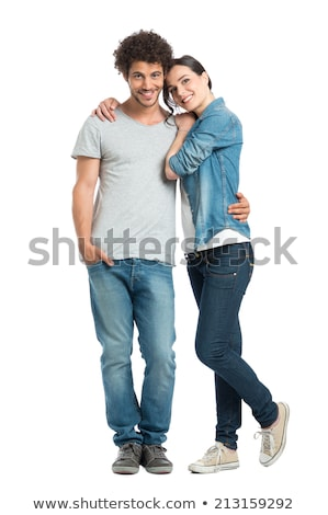 Happy young loving couple standing isolated Stock photo © deandrobot