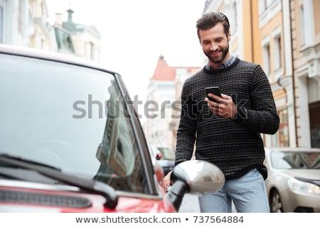 Homme téléphone cellulaire souriant affaires téléphone affaires Photo stock © IS2
