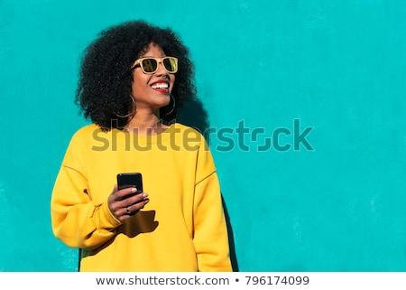 portrait of a pretty afro american woman stock photo © deandrobot