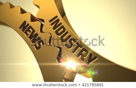 Industry News on the Golden Metallic Gears. Stock photo © tashatuvango