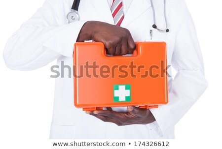 Young african doctor holding a first aid box. Stock photo © RAStudio