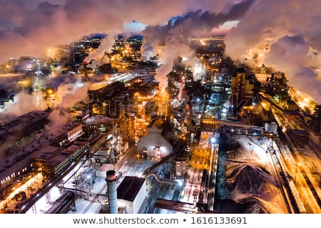 metallurgical plant at night steel factory with smokestacks stock photo © denbelitsky