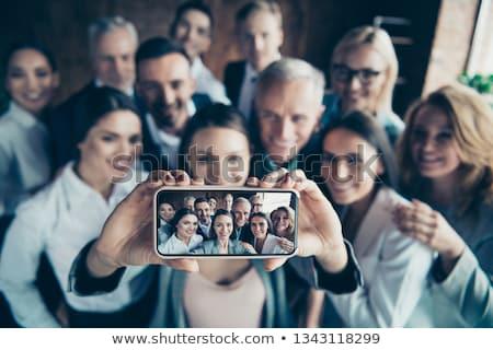 érett lány elvesz portré okostelefon igazgató Stock fotó © 2Design