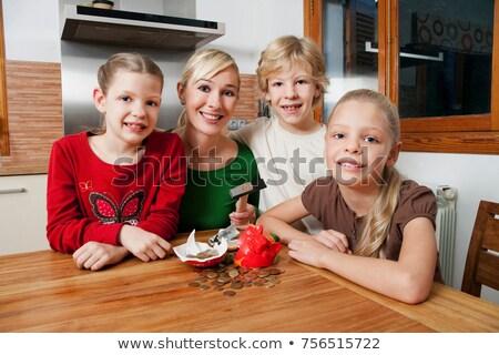 Family smash open a piggy bank Stock photo © IS2