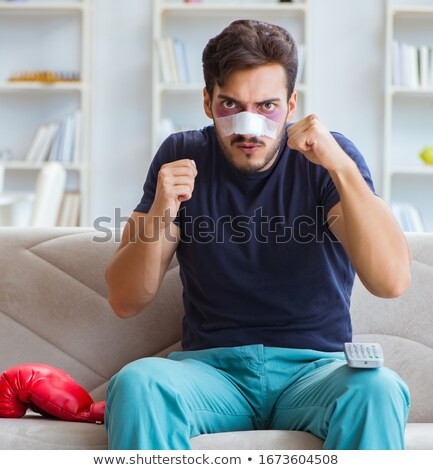 Stock photo: Young man defeated in sports game suffered loss with broken blee