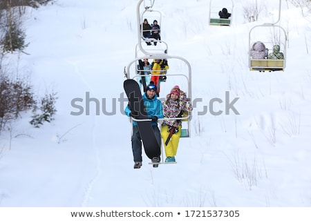 Caucasian couple skiers using cableway at ski resort. Stock photo © RAStudio
