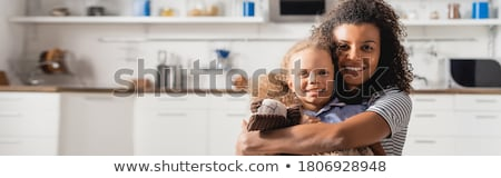 Stock photo: Woman holding camera and teddy bear
