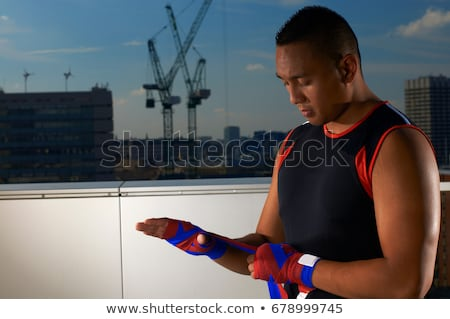 Boxer wrapping hands on urban rooftop Stock photo © IS2