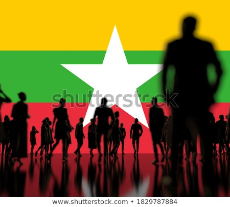Man with flag of myanmar in a crowd Stock photo © MikhailMishchenko