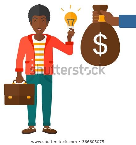 Afrika adam bavul dolar işareti işadamı eller Stok fotoğraf © studioworkstock