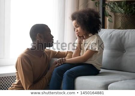 Fiatal lány térdel kanapé gyermek női Stock fotó © IS2