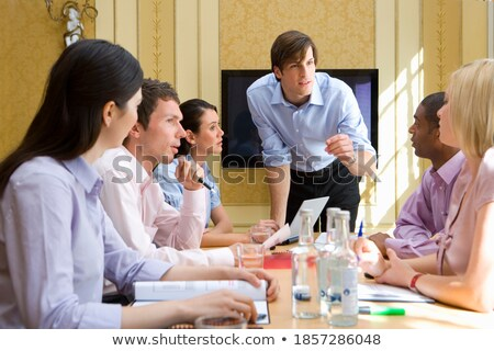 Businessman leaning on conference table with documents Stock photo © IS2
