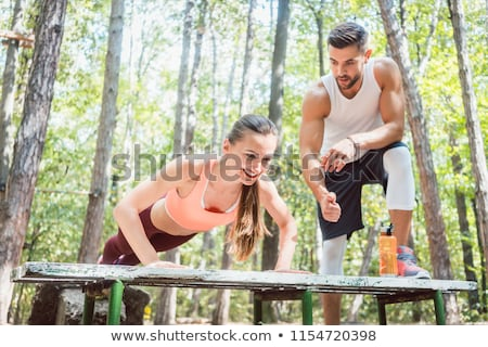 Man and woman doing functional fitness in outdoor gym Stock photo © Kzenon