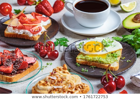 Cup of coffee with fruit sandwiches Stock photo © Melnyk