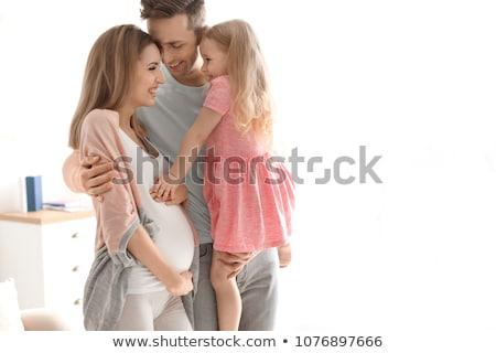 Famiglia felice incinta madre home gravidanza persone Foto d'archivio © dolgachov