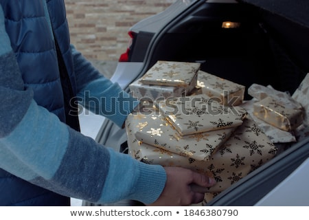 Santa Claus transports Christmas presents by car Stock photo © Ustofre9